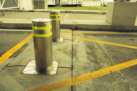 bollards with Security at the gate vintage tone