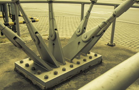 struts: Steel column support with bolts and nuts.vintage tone