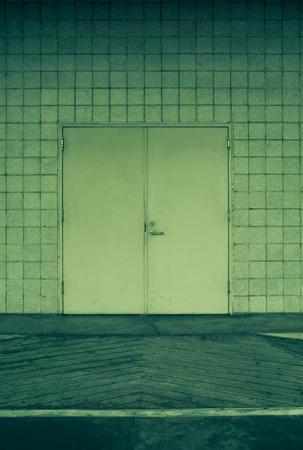 defense facilities: steel door and concrete surrounding.vintage tone