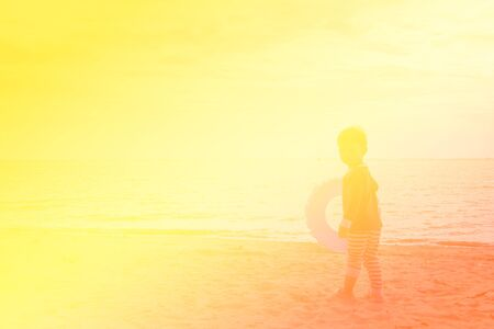 children background: Silhouette of a Boy Walking into the Ocean, color effect