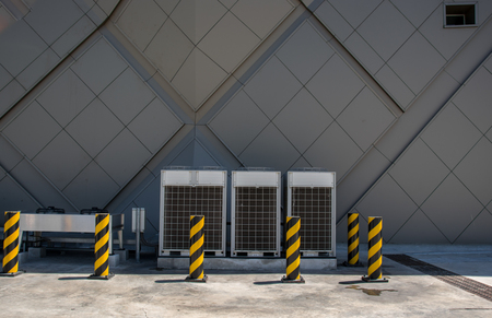 condenser: Row of commercial HVAC air conditioner outside condenser cooling and refrigeration conditioning system Stock Photo