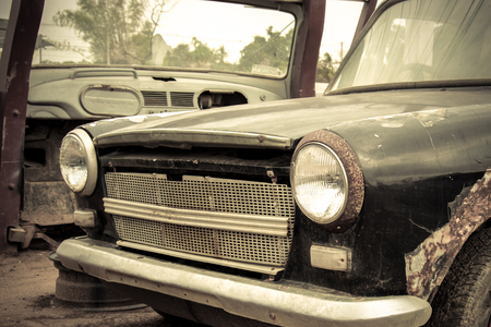 Cemetery car, abandoned old car in garage. Retro and vintage style. Stock Photo