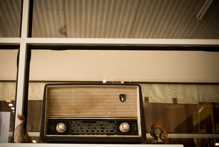 the Obsolete radio in wooden case. Horizontal indoors shot