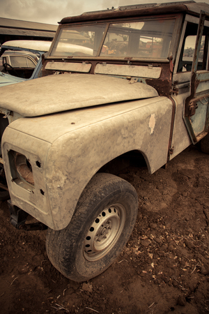 Cemetery Car, Abandoned old car in garage. retro and vintage style. Imagens