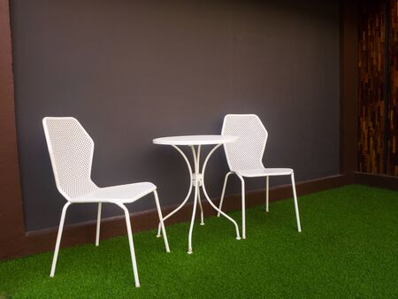 the tables and chairs in front of soft blue wall - Image