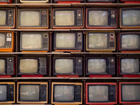 Wzór ściany stosu starego retro TV bachground