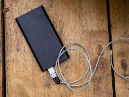 The Wooden portable external power bank, for emergency phone recharge