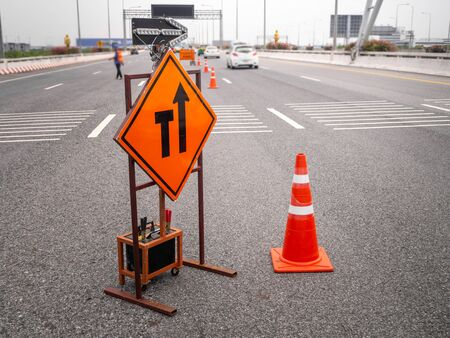 The signs repairs road and worker on the road