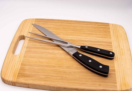 carving board with carving knife and fork Banco de Imagens