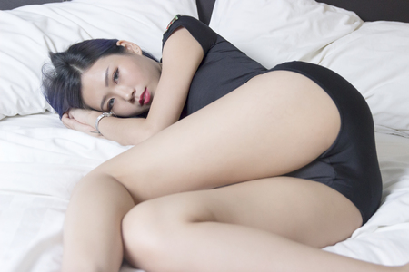 Sexy Chinese girl sleeping on bed