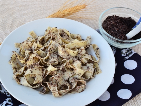 Traditional Hungarian noodles with ground poppy seeds and sugar.