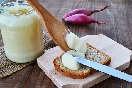 Homemade pork lard being spread on bread. Stockfoto