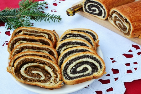 Traditional beigli with walnut and poppy seed filling slices on a plate