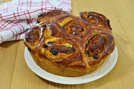 Easter sweet bread with raisins and Turkish delight for on wooden table.