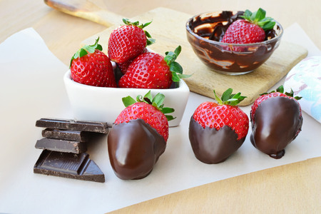 Fresh strawberries covered with dark chocolate. photo