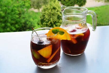Sangria - refreshing fruit punch beverage in pitcher and glass. photo