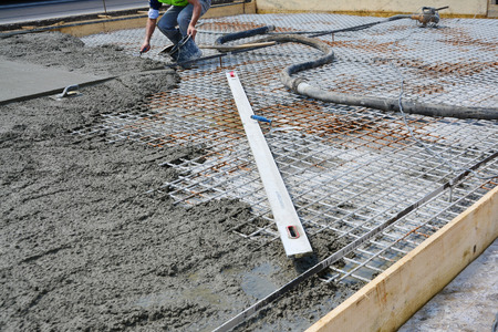 Roadwork, mesh reinforcement for concrete slab at road upgrade  photo