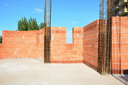 hollow wall: Confined masonry. Load-bearing clay blockwall confined at the corners with reinforced concrete tie-columns.