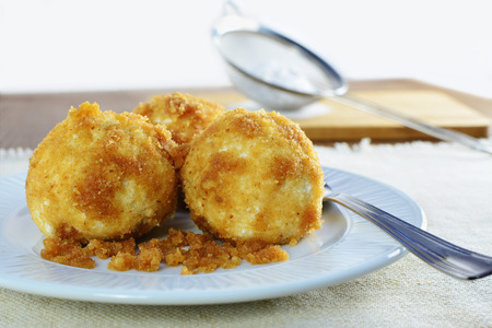 breadcrumbs: Cottage cheese dumplings with breadcrumbs on white plate. Shallow dof.