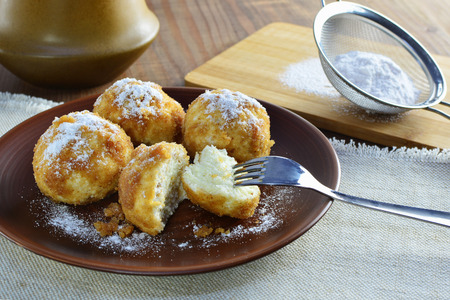 Cottage cheese dumplings with breadcrumbs and powdered sugar.