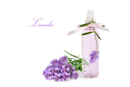 Lavender product in spray bottle and flowers isolated on white background. Stockfoto
