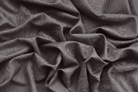 Brown silk damask fabric with wavy pattern. Wavy textured background. Фото со стока