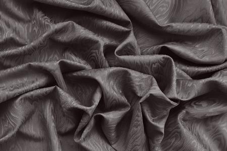 Brown silk Damast Stoff mit Wellenmuster. Wellenförmig strukturierten Hintergrund. Standard-Bild - 39904994
