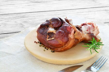 crock pot: Smoked ham hock cooked. Fall-off-the-bone crock pot ham on wooden plate.