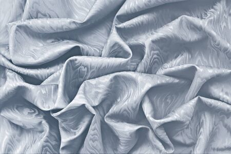 moire: Silver silk damask fabric wavy texture background.