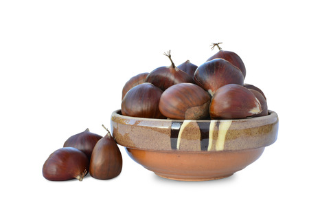 castanea sativa: Sweet chestnuts (Castanea sativa) in bowl isolated on white background.