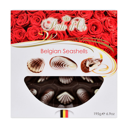 perle: CLUJ-NAPOCA, ROMNIA - NOVEMBER 19, 2015: Perle dOr Belgian seashell chocolate truffles. Belgian chocolate is worldwidely regarded as superior because of its well balanced taste and fine structure.