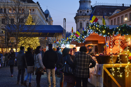 chalets: CLUJ-NAPOCA, ROMANIA - DECEMBER 5, 2015: Unidentified people do Christmas shopping at traditional market chalets.