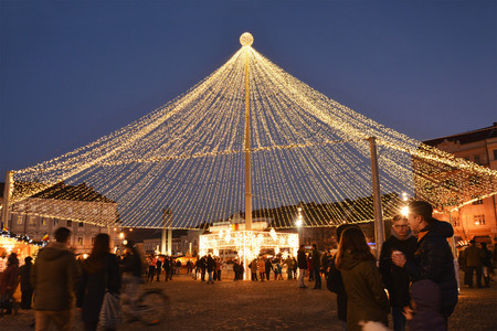 chalets: CLUJ-NAPOCA, ROMANIA - DECEMBER 5, 2015: Unidentified people shop for Christmas at traditional market chalets. Christmas market light dome in the evening. Editorial