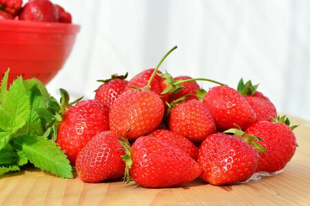 vitamine: Pile of ripe strawberries on wooden table. Stock Photo