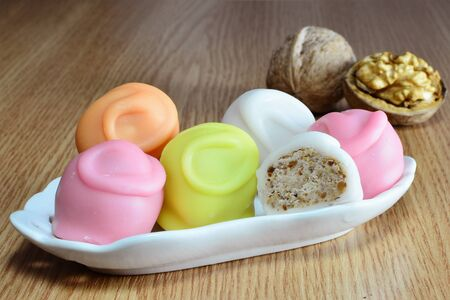coatings: Fondant coated candies with creamy nut filled center Stock Photo