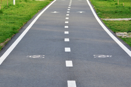 bikeway: Bike lane with bike sign painted on the asphalt Stock Photo