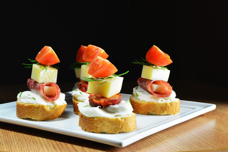 fingerfood: Fingerfood,cheese, salami, sausage slices and tomatoes Stock Photo