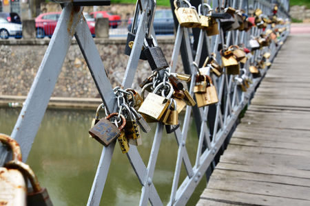 affixed: Love padlocks on bridge symbol of commitment and eternal love. Stock Photo