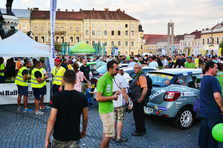 national championship: CLUJ-NAPOCA, ROMANIA - JULY 21, 2016: People admire the race car before the opening ceremony of the Transylvania Rally National Championship Editorial
