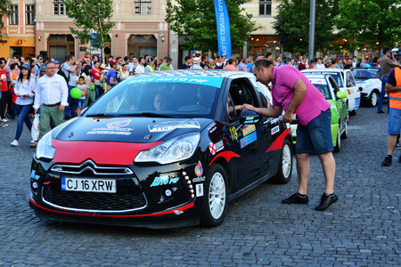 national championship: CLUJ-NAPOCA, ROMANIA - JULY 21, 2016: Race cars arrive for the opening ceremony of the Transylvania Rally National Championship - Dunlop 2016.