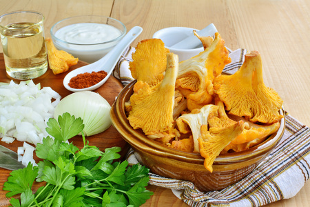 peppery: Chanterelle mushrooms and ingredients for cooking sauteed muchrooms.