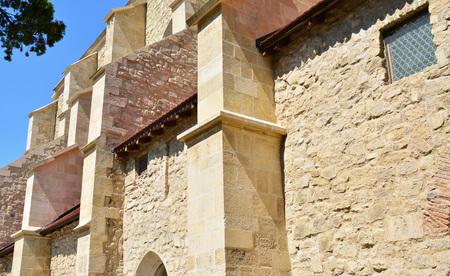 exterior architectural details: Exterior stone walls of an old church, architectural details. Stock Photo