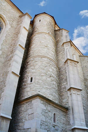 exterior architectural details: Old church exterior stone walls and columns with small windows (oculus), Architectural details. Stock Photo