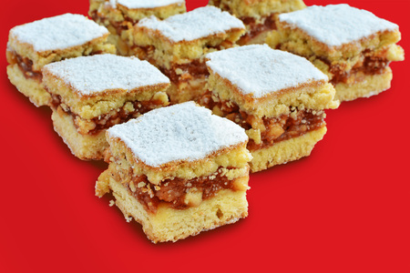 Apple pie bars with cinnamon on red tray