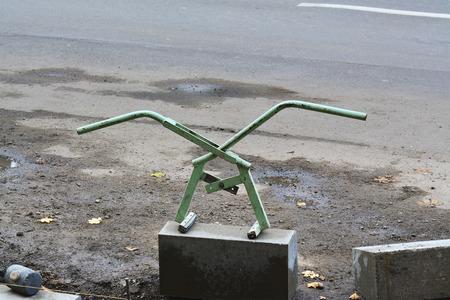 kerb: Adjustable lifter for manual handling of curbs. Scissor type manual kerb lifter. Stock Photo