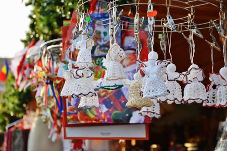 crocheted: Crocheted handmade Christmas decorations hanged at a stand at Christmas market