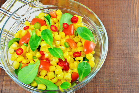 Fresh vegetable salad with corn, lambs lettuce, tomatoes, chilly and sweet pepper Stock Photo