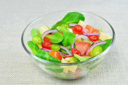 Fresh vegetable salad in glass bowl on the table