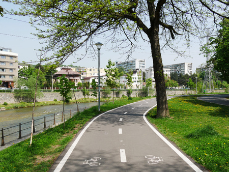 Dedicated bike path adjacent to pedestrian walkway along the river Stock Photo