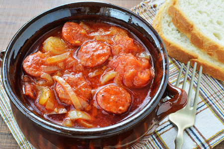 Vegetable stew, lecho in ceramic pot with bread